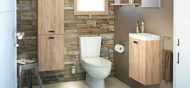 Meuble lave-mains avec rangement dans toilettes spacieuses