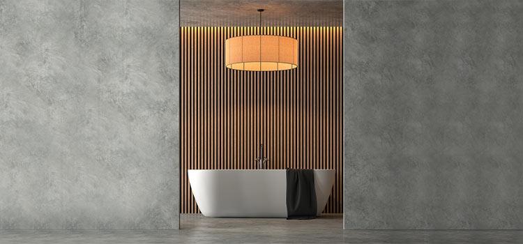 mur en pierre laissant entrevoir une baignoire de salle de bains